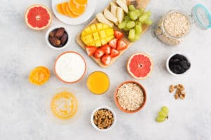 Top view of a healthy habits breakfast with oats and fruits
